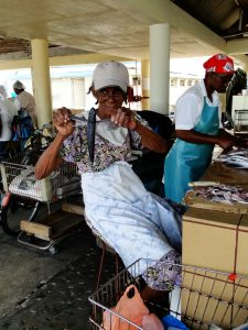 Barbados - Fish Market Woman holding Flying Fish
