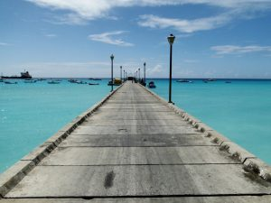 Pier stretching out in turquoise blue water